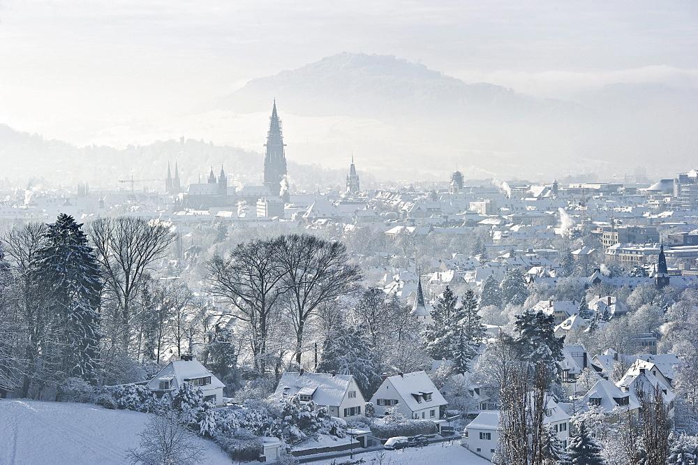 Christmassy and snowy panorama of Freiburg im Breisgau, Black Forest, Baden-Wuerttemberg, Germany, Europe