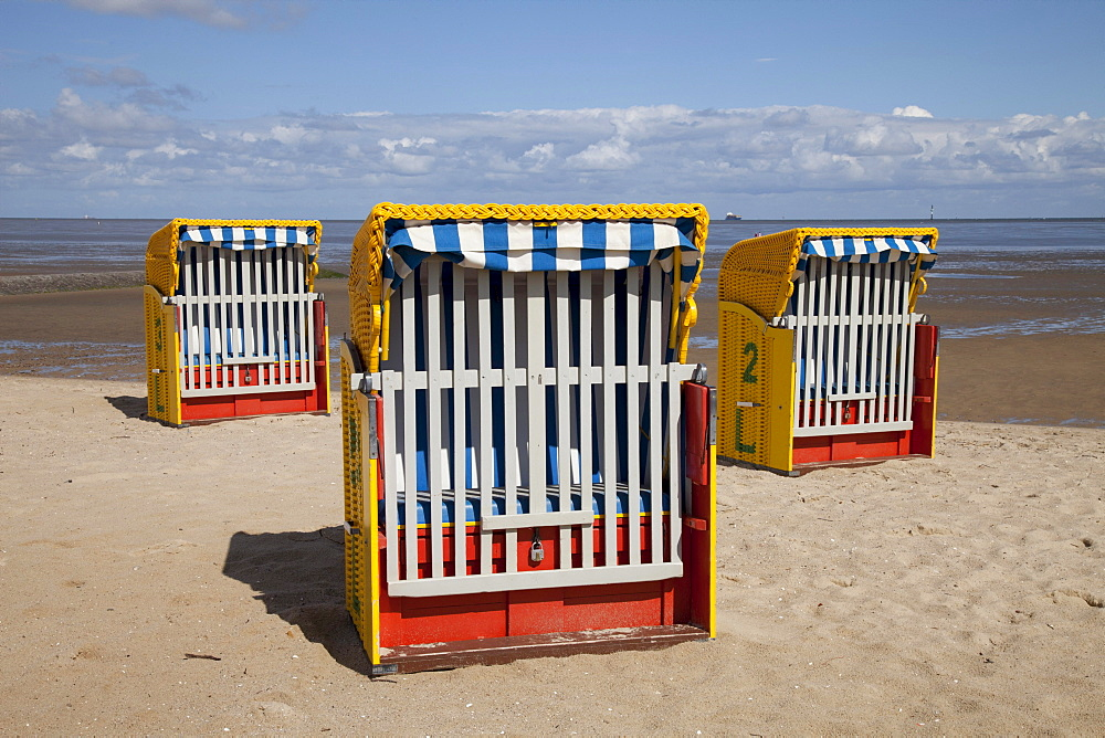 Roofed wicker beach chairs on a sandy beach, mud flats, Cuxhaven, North Sea, Lower Saxony, Germany, Europe