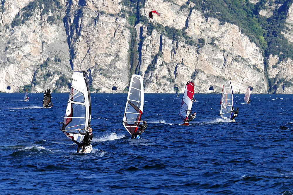 Wind surfers surfing in strong winds on Lake Garda in Malcesine, Veneto, Italy, Europe