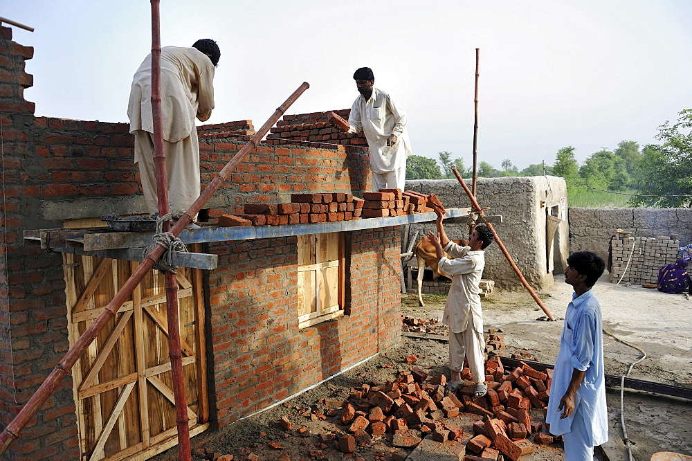 Construction of brick houses for families whose homes were destroyed during the flood catastrophe of 2010, Lashari Wala village near Muzaffaragarh, Punjab, Pakistan, Asia