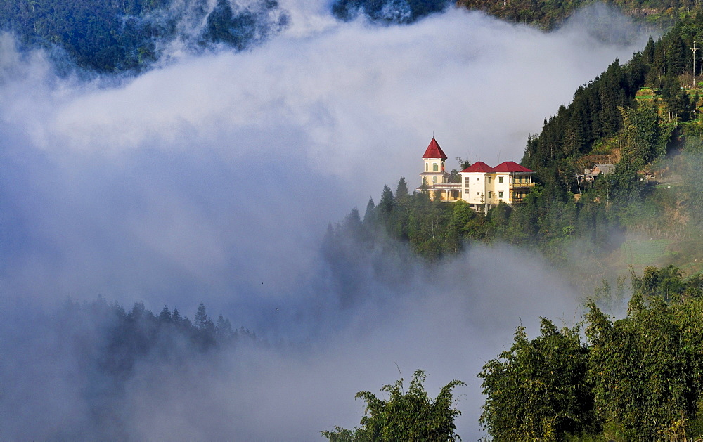 Villa in the early morning with cloud sea in the mountains in Sapa or Sa Pa, Lao Cai province, northern Vietnam, Vietnam, Southeast Asia, Asia