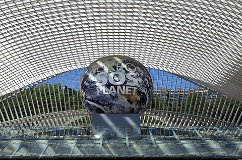 "Entrance of the station concourse, a globe with the inscription ""EXPO SOS Planet"" as a reference to the candidacy of Liege for the World's Fair 2017, Gare de Liege-Guillemins railway station, architect Santiago Calatrava, Liege, Luik, Wallonia, Belgium, E"