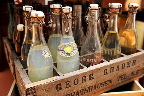 Old beverage bottles with swing tops in a wooden box, Heimatmuseum Wolfratshausen museum for local history, Upper Bavaria, Bavaria, Germany, Europe