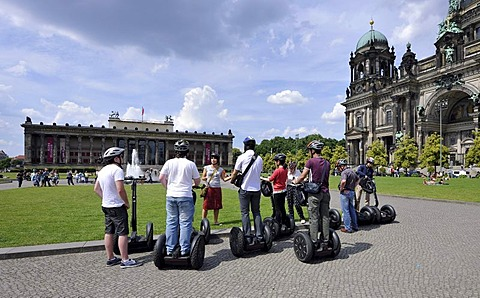 City tour for tourists riding Segways, in front of Berlin Cathedral, Supreme Parish and Collegiate Church in Berlin, and Altes Museum, Lustgarten pleasure garden, Museum Island, UNESCO World Heritage Site, Mitte district, Berlin, Germany, Europe, PublicGr