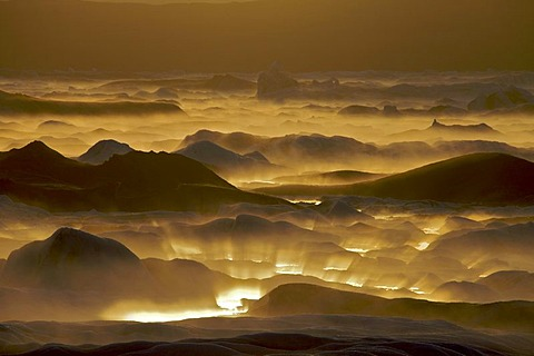 Reflection of the setting sun in the fog over the Joekulsarlon glacial lake, south coast, Iceland, Europe