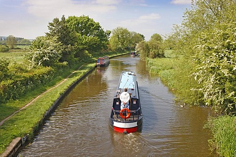 Canal barge on the Trent & Mersey Canal from Lowes Lane Bridge near Swarkestone, Derbyshire, England, United Kingdom, Europe