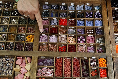 Colorful glass beads for sale in a type case, Flachsmarkt historical crafts market, Krefeld-Linn, North Rhine-Westphalia, Germany, Europe