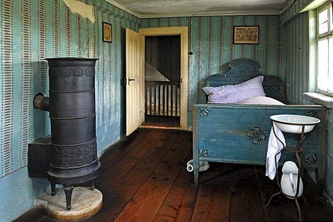 Retiree's room with stove and bed, 1911, farmhouse from Herrnbechtheim, Franconian open-air museum, Eisweiherweg 1, Bad Windsheim, Middle Franconia, Bavaria, Germany, Europe