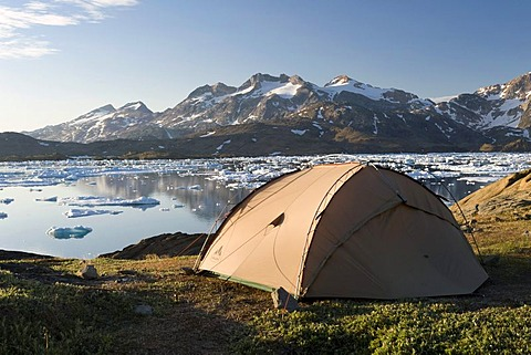 Tent, floating ice sheets and mountains, Tasiilaq or Ammassalik, East Greenland, Greenland