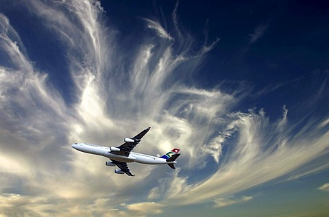 South African Airbus A340-600 jet aircraft against cloudy sky