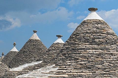 Group of Trulli, traditional Apulian stone dwellings with conical roofs and pinnacles, Alberobello, Bari province, Puglia region, Italy, Europe