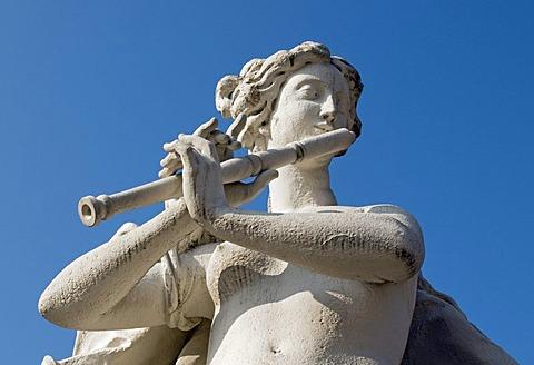 Baroque sculpture of flute player in Belvedere Palace Park, Wien, Vienna, Austria, Europe