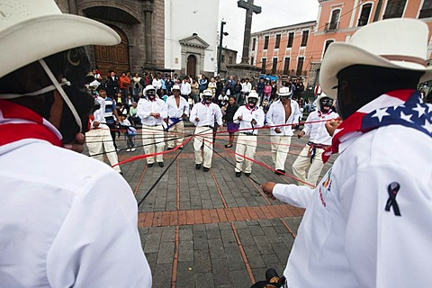 Male dance group on the edge of a procession, car-free Sunday in the historic centre of Quito, Ecuador, South America