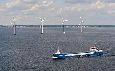 "Cargo ship ""Wilson Astakos"" sailing in front of an offshore wind farm in the oresund outside Copenhagen, Denmark, Europe"
