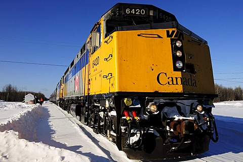 Ice-covered train on the railway line between Winnipeg and Churchill, Manitoba, Canada