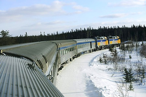 Train moving on the railway line between Winnipeg and Churchill, Manitoba, Canada