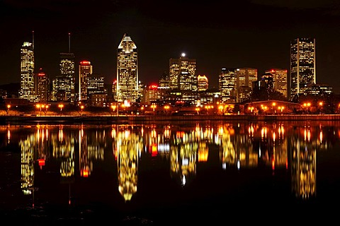 Skyline of Montreal reflected in the St. Lawrence River, Montreal, Quebec, Canada