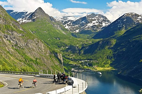 Tourists looking down on the Geiranger fjord, Norway, Europe