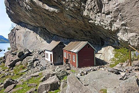 Houses under Helleren mountain ledge, Sokndal, Norway, Europe