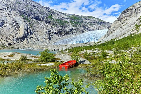 Red boat, Nigardsbreen, Jostedalen valley, Luster, Sogn og Fjordane county, Norway, Europe
