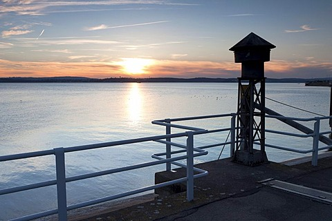 Old fog horn on the pier in Meersburg on Lake Constance, overlooking the lake towards Konstanz at sunset, Baden-Wuerttemberg, Germany, Europe