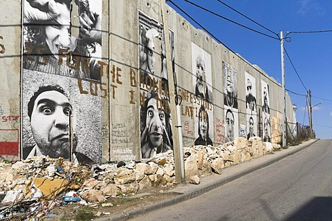"""A group of posters on the controversial """"security fence"""", a wall built by the Israelis to separate themselves from the Palestinians, Bethlehem, West Bank, Western Asia"""