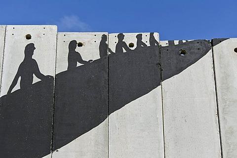 A banksy graffiti on the separation wall, Bethlehem, West Bank, Western Asia