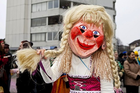 Individual dressed as a cheeky blond Bavarian Oktoberfest girl during the carnival procession, Littau, Lucerne, Switzerland, Europe