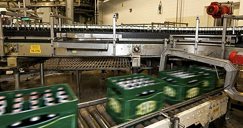 Filled beer crates on a conveyor belt with motion blur, Binding brewery, Frankfurt, Hesse, Germany, Europe
