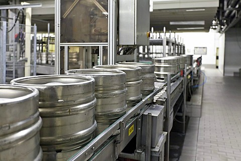 Beer kegs on a conveyor belt, waiting to be filled, Binding brewery, Frankfurt, Hesse, Germany, Europe