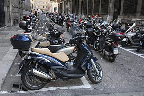 Parking area for motorcycles and motor scooters in the historic district of Trieste, Italy, Europe