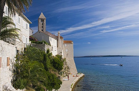 Promenade on the coast and view on the steeples of the town of Rab, Rab island, Kvarner Gulf, Croatia, Europe