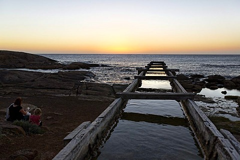 People at the wooden water channel leading to the Cape Leeuwin water wheel, Augusta, Western Australia, Australia