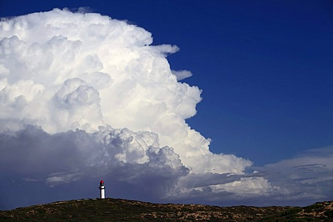 Point Quobba Lighthouse with big rain cloud in the distance, Western Australia
