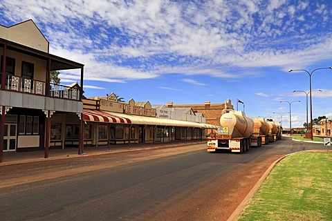 Shops and trucks in Austin Street, Cue Murchison, Western Australia, Australia