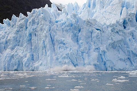 Ice falling off Garibaldi Glacier, Darwin National Park, Tierra del Fuego, Patagonia, Chile, South America