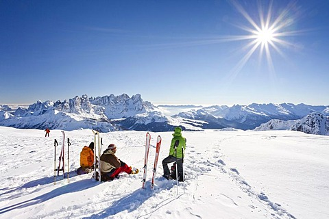 Skiers on the Uribrutto summit above the Passo Valles, behind the Pala group and the Passo Rolle, Dolomites, Trentino, Italy, Europe