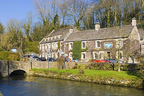 The Swan Hotel over river Coln, Arlington, Bibury, the Cotswolds, Gloucestershire, England, United Kingdom, Europe