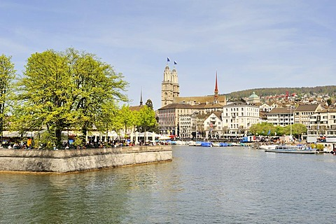View across the Limmat River towards the beer garden on Bauschaenzli square, Altstadt promenade and the two steeples of Grossmuenster church at the back, Canton of Zurich, Switzerland, Europe