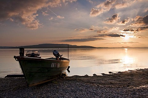 Sunset on Reichenau island with fishing boat and cloud reflection, Baden-Wuerttemberg, Germany, Europe