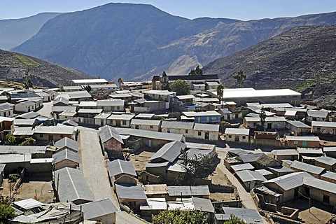 Overview, corrugated iron roofs, houses, mountains, Socoroma village, Putre, Altiplano, Norte Grande, northern Chile, Chile, South America