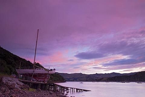 Sunrise over Akaroa Harbor, Banks Peninsula, Canterbury region, South Island, New Zealand