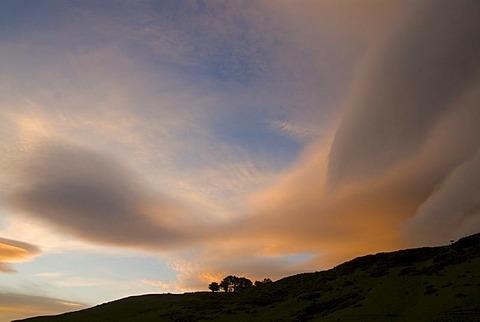 Dramatic sunset clouds near Tunnel Beach, South Island, New Zealand