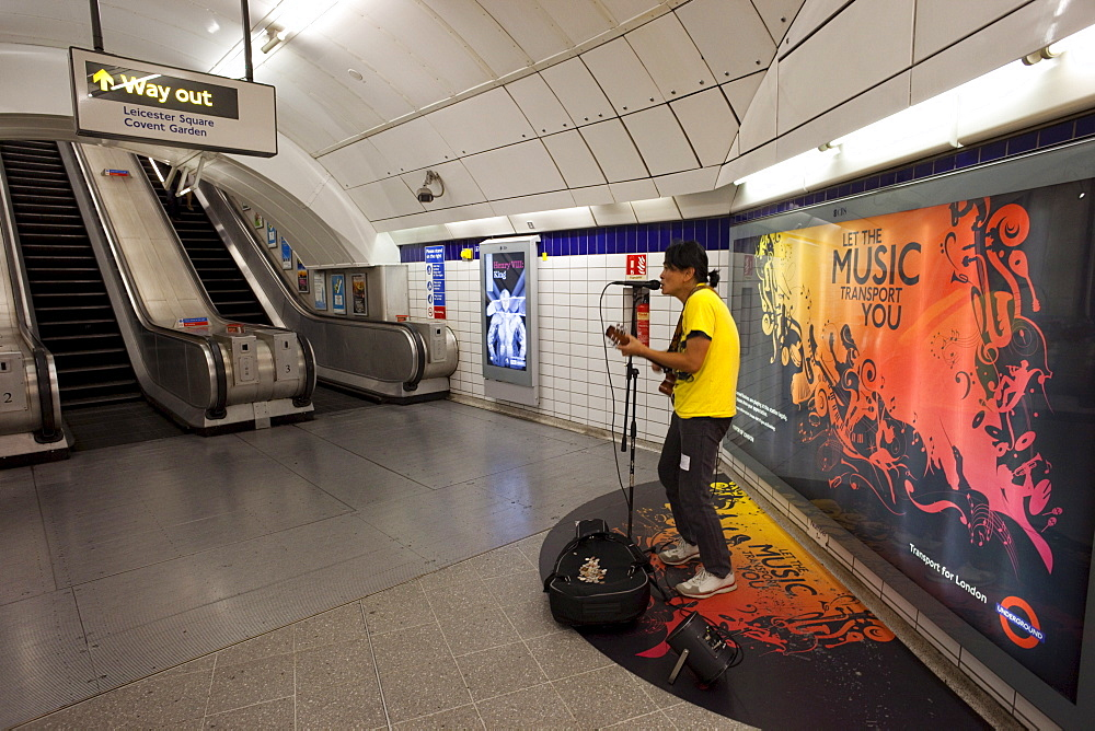 Busker in Underground Station, London, England, United Kingdom, Europe