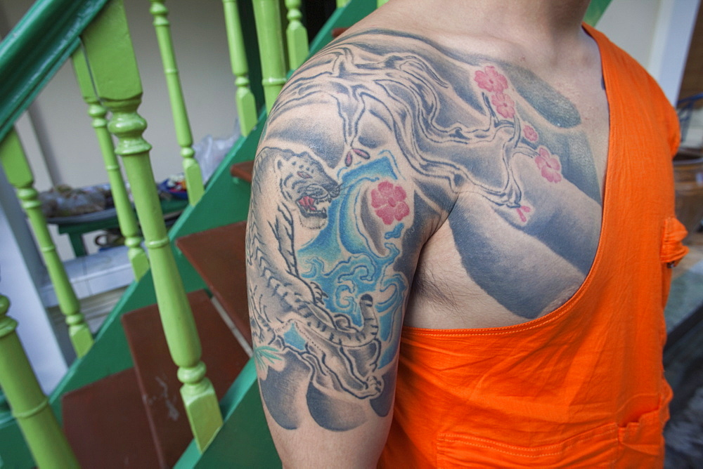 Monk with tiger tatoo on upper arm, Bangkok, Thailand, Southeast Asia, Asia