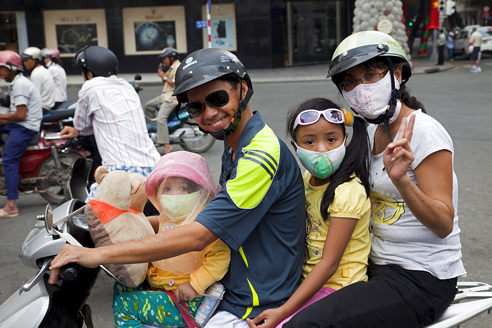 Motorbike passengers wearing pollution mask, Ho Chi Minh City, Vietnam, Indochina, Southeast Asia, Asia  - 834-1985