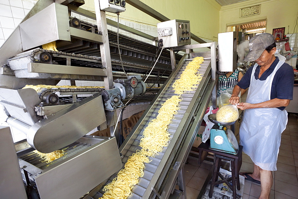 Noodle making machine, Chinatown, Singapore, Southeast Asia, Asia