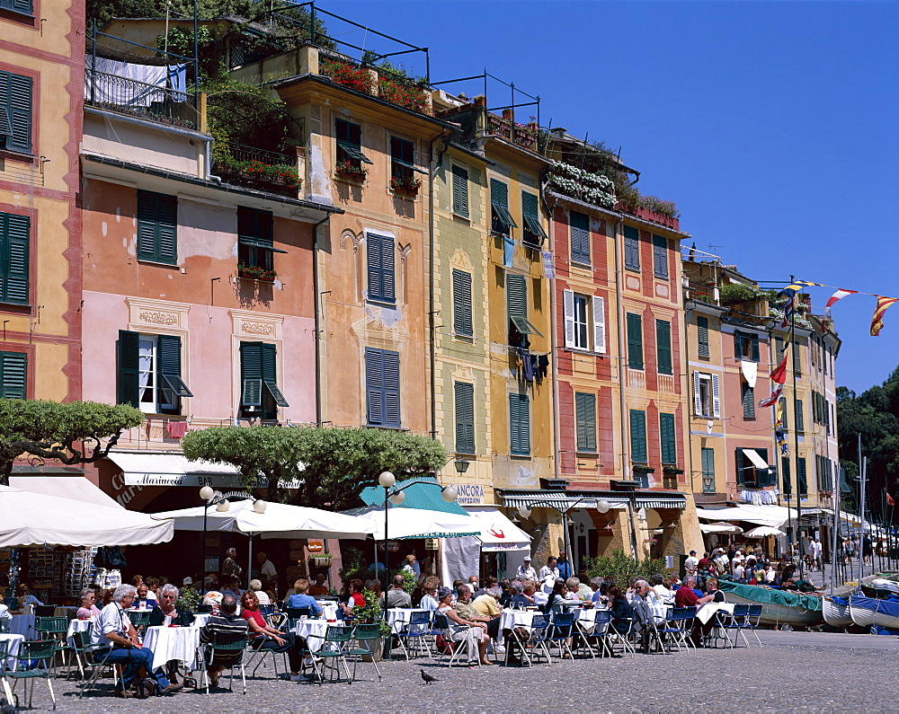 Pastel coloured houses and pavement cafes, Portofino, Liguria, Italy, Europe