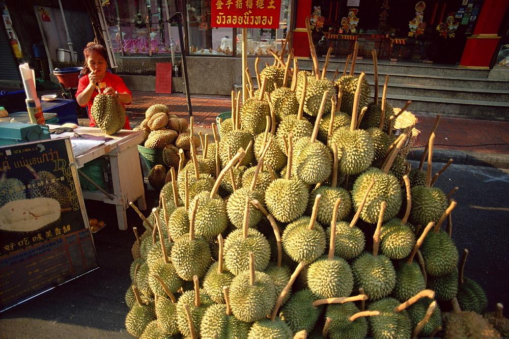 Woman street vendor selling durians, Bangkok, Thailand, Southeast Asia, Asia