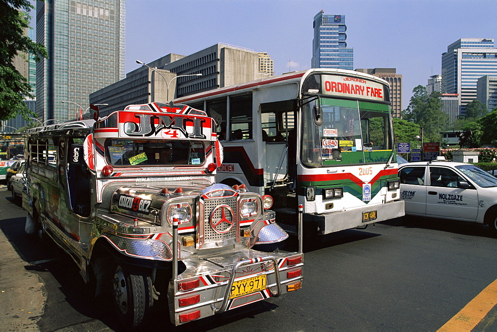 Typical traffic scene showing Jeepney, bus and taxi, Manila, Philippines, Southeast Asia, Asia